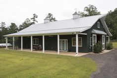 This horse barn was built for Charles & Sandy of Thomasville, GA Special Features: Morton's Hi-Rib Steel Cupolas Porches Eyebrow Overhang ...