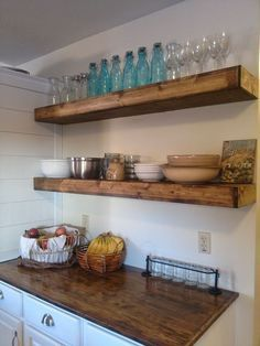 $20 DIY Floating Shelves - After taking down a bay of cabinets in my kitchen and looking at a bare wall for about a month, I had to make a decision on what kind…