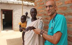 Dr. Tom Catena, the only physician permanently in Sudan's Nuba Mountains, examined a leprosy patient, Nemat Kuku, whose child Nasra Makous is malnourished. Both leprosy and malnutrition are common in the area. (Photo by Nicholas Kristof/The New York Times)