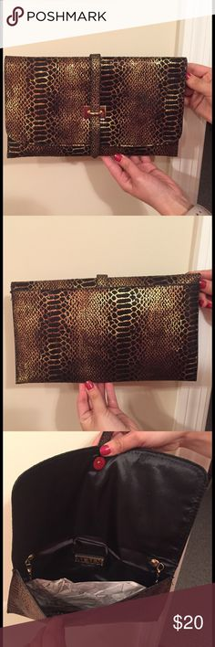MMS Animal Print Clutch Gold, bronze, brown & black faux snakeskin envelope style evening clutch with attached gold chain shoulder strap. Like new, only used 2-3 times. Excellent condition. Bags Clutches & Wristlets