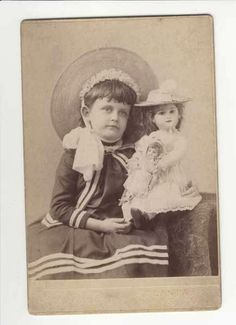 ATLANTA PHOTOGRAPHER - CABINET CARD OF A GIRL WITH HER DOLLS BY C.W. MOTES 33 1/2 WHITEHALL ST., ATLANTA, GA. CHRISTMAS 1887.