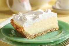 Melted white chocolate covers a coconut and graham cracker crust that is filled with coconut pudding and whipped cream for a cool and luscious pie.