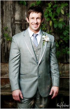 Gray suit with vest and an orchid boutonniere - Photo by Jason