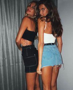 Her short denim mini skirt barely covers her bare bum