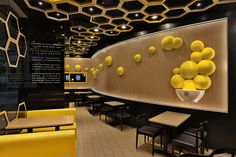 Visual Merchandising | Display | Irregular hexagons are distributed throughout the 'rice home' restaurant located in guangzhou city, china by hong kong company - as design.