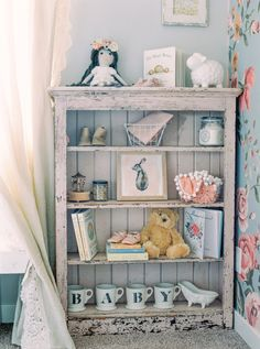 """Vintage book and trinket shelf: <a href=""""http://www.stylemepretty.com/living/2016/12/06/vintage-floral-nursery-and-a-stunning-maternity-shoot/"""" rel=""""nofollow"""" target=""""_blank"""">www.stylemepretty...</a> Photography: Justine Milton - <a href=""""http://www.justinemilton.com/"""" rel=""""nofollow"""" target=""""_blank"""">www.justinemilton...</a>"""