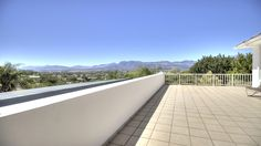 The balcony/deck is wide and offers terrific views. Host a summer cocktail party or family get-together and watch the town lights twinkle on. #paarl #views #balcony #deck #veranda #terrace #southafrica #property #realestate