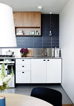 Kitchen appliances, refrigerator and an oversized pantry are all concealed behind cupboard doors.