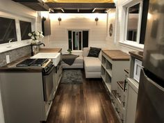 House by Sun Bear Tiny Homes The living room has an elevator bed with twin size mattress. The bed raises and lowers at the touch of a button.The living room has an elevator bed with twin size mattress. The bed raises and lowers at the touch of a button. Best Tiny House, Tiny House Cabin, Tiny House Living, Tiny House Plans, Tiny House On Wheels, Home Living Room, Kitchen Living, Small Living, Modern Living