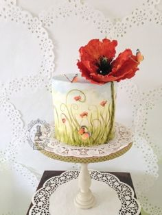 {Pleasing gumpaste Poppy on a painted cake by Firefly India by Pavani Kaur}