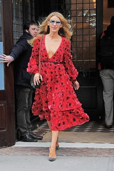 Blake Lively makes a statement in this Michael Kors floral dress, Chanel bag, and Christian Louboutin pumps