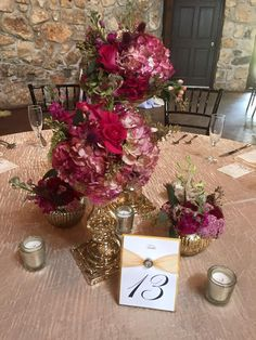 Wedding Flowers. Ceremony Centerpieces. Gold mercury Vases. Gold mercury stands. Pink and Gold. Table Numbers. Pink Flowers. Pink Hydrangea. Pink roses. Antique Hydrangea. Seeded Eucalyptus. Tablescape. Table centerpiece. Clustered flowers. Clustered arrangements. Gold and Pink. Bold Pink flowers. Oakleaf Florist.