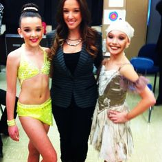 Maddie and Kendall from dance moms wearing costumes purchased from Crystalcoutureinc.com consignment costumes.