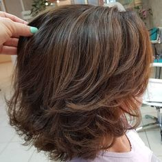 Medium Length Haircut With Flipped Layers Voluminous Cut with Swoopy Layers This is also one of those medium length haircuts that are a blast from the past. The rich chocolate brown color is lowkey and stylish. Flipped layers are cute and feminine. Medium Length Hair With Layers, Medium Hair Cuts, Short Hair Cuts, Medium Hair Styles, Curly Hair Styles, Short Hairstyles For Thick Hair, Haircut For Thick Hair, Crimped Hairstyles, Full Fringe Hairstyles