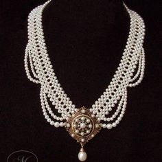 Woven seed pearl necklace with elegant graduated pearl drapes and antique rose gold snowflake brooch.