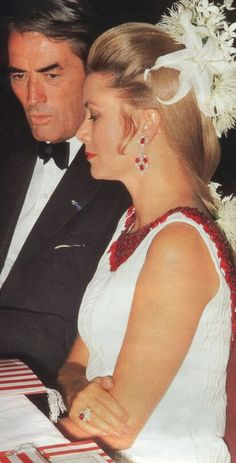Gregory Peck and Grace Kelly 1970 at a ball in Monoco.