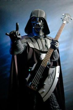 I doubt there is a cooler image in existence ... Darth Vader, metal horns and a Gene Simmons bass. \m/