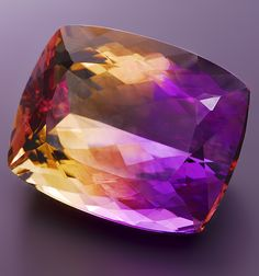 Here is one gorgeous multi-colored Ametrine Cushion, weighing 27.19 cts, from Bolivia. Ametrine is an unusual variety of quartz which exhibits the colors of amethyst and citrine side by side.
