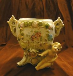 """Vintage Vase W/ Flowers & Baby with Blond Hair Gold Gilding Vase   Measures: 4 3/4"""" x 4""""  Great addition to anyones collection.   Condition:  Very Good. It has no markings, no chips, and no cracks."""