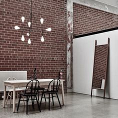 Nice minimal interior at Criteria Collection in Melbourne featuring lights by Apparatus