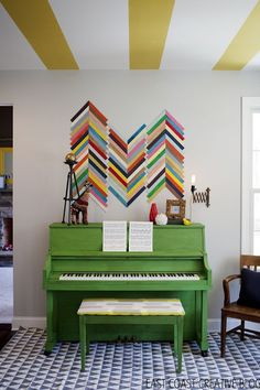 A break from the expected piano finish. This room is not afraid of some color. #green #decor #diy