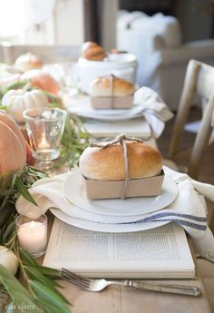 Fall Tablescape with mini breads, soup, and vintage books as chargers…