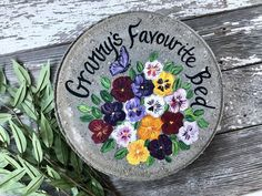 Hand painted garden stones and wedding glassware by Painted Stepping Stones, Painted Bricks, Hand Painted, Mother Of The Groom Gifts, Mother And Father, Mom And Grandma, Grandma Gifts, Bridal Wine Glasses, Grandmother's Day