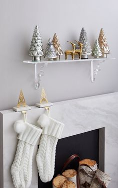 No mantel? No problem! Try hanging a shelf that's narrower but complementary to your fireplace surround and get creative with holiday decor and stockings. The possibilities are endless. Find the solution that works for you in store! Cabin Christmas Decor, Gold Christmas Decorations, Christmas Mantels, Gold Decorations, Fireplace Decorations, Winter Decorations, All Things Christmas, Christmas Home, Christmas Holidays
