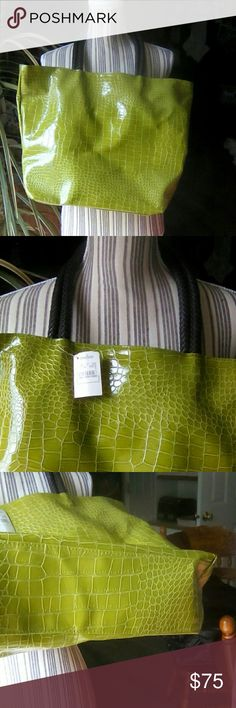 "Neiman Marcus Green NWT Tote Crocodile Print Neiman Marcus, green, NWT, tote bag. It is crocodile print. The handles are brown, and braided. Box bottom. Very classy tote bag. I don't remember if this is real leather. It smells like leather, so I don't want a vegetarian buying this just in case. Smoke free home. It just has the one main pouch. Silky, green lining. Measures approximately 16-1/2"" x 13"".  Top off the handle to the top of the bag is approximately 8-1/4"". Neiman Marcus Bags Totes"