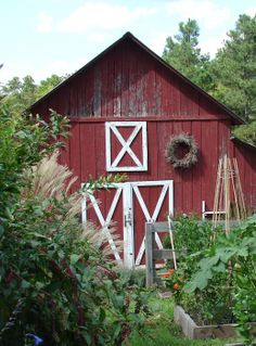 Little red barn and a garden @aprilfairwater