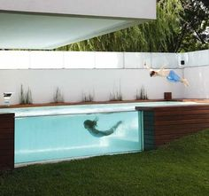 The most amazing above-ground pool I've ever seen! Designed by Andres Remy Architects, modern pool in Devoto, Argentina.