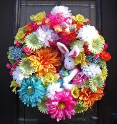 love how over the top this flower and bunny wreath is