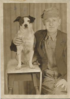 With his much loved dog.
