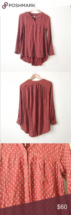 Free people long sleeve blouse Long sleeve high low blouse with pattern. Buttons don't go all the way down . They stop at around belly button / lower belly area. Free People Tops Blouses