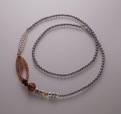 Long necklace: Grey, pink and white pearls, aquamarine, Welo opal, garnet, Murano glass, quartz, yellow and rose gold filled parts, sterling silver, handmade quartz and 950 silver beads.