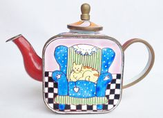 What a cheeky cat sat in a chair! Courtesy of nivagcollectables.co.uk - Charlotte di Vita miniature teapot