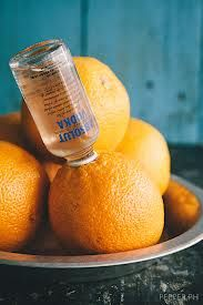 small bottle of vodka in an orange - perfect for a concert/ anywhere else you have to smuggle in alcohol
