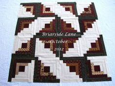 Interesting arrangement of Log Cabin blocks. Briarside Lane