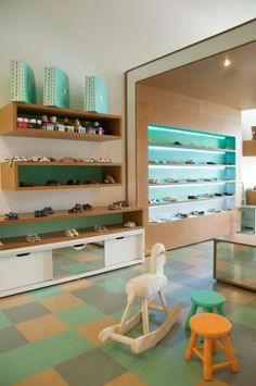 BUNNY EARS – BABY & KIDS SHOE STORE YTÅ created a shoe store for small children, where the main idea was that of a shoe box, inserted into a white, empty spa...