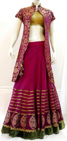 Purple net lehenga with banaras, velvet and antique borders matched with antique brocade blouse with purple & gold floral print pure brocade jacket
