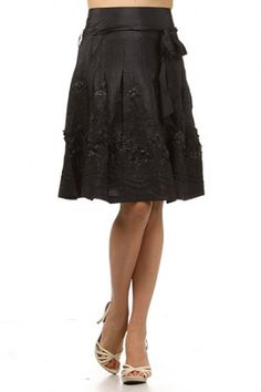 100 percent Polyester 1S/1M/1L Per Pack Black(shown) This HIGH QUALITY skirt is BEAUTIFUL!! Very nicely embroidered, this adorable A-line skirt with waist tie is made from a light and comfy fabric that is hand washable, and fits true to size.