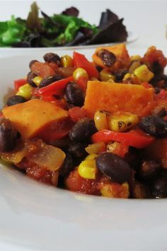 This slow cooker sweet potato chili is an easy chili recipe! Cook the best chili recipe using sweet potatoes, tomatoes, kidney beans, black beans, and brown sugar. You will love making this vegetarian chili crockpot recipe for a lunch or dinner in the fall and winter!