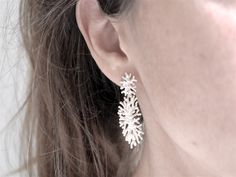 Double handmodelled coral earrings from silver.