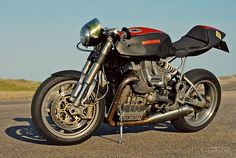 I really like the look on this Guzzi. I would move the headlight closer to the forks and lower it. Otherwise near perfection.