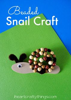 Turn a scoop stick and wood beads into this adorable Beaded Snail Craft. A great summer kids craft and for summer camp.