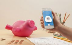 'Porkfolio', a Wifi-enabled smart piggy bank that links up to your phone to track savings and set financial goals: http://www.walletburn.com/Porkfolio-Piggy-Bank_836.html