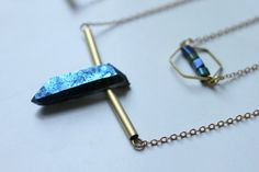 ※ Multi-raws necklace with one blue quartz and blue hematites cubes.  ※ Total lenght : 35 cm Material : Brass gold ton. Peach quartz come from Asia.