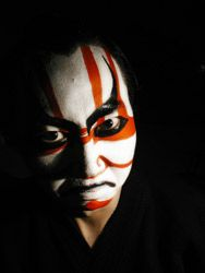 As theater evolved, the actors began using make-up as masks, such as illustrated here with the Kabuki man. They began to replace the masks with make-up. Reason being, it was much easier to use make-up than to use a mask because you didn't have to worry about it falling off or scratching your face.