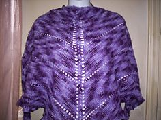 A very simple triangle shawl worked in sport weight yarn. Can be made longer by continuing repeats to the desired length at center spine.