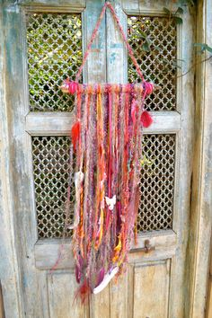 WALL HANGINGS, made from hand spun and hand dyed wools, vintage bone beads, hand painted feathers. one of a kind, stunning earthy & unique: found on Etsy/ Venicebeachmama